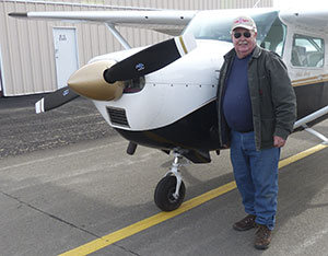 Terry Matter, SAUA Board Member standing in front of his C-182 at the Reno-Stead Airport.